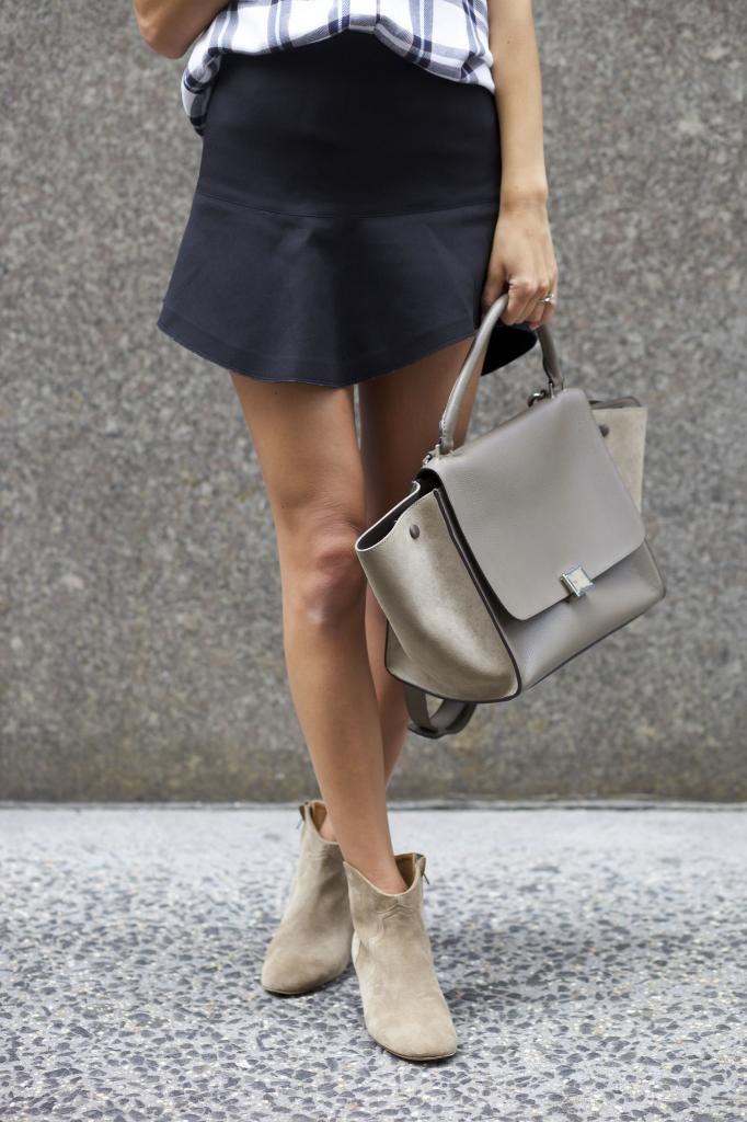 Arielle Nachmani is wearing a suede shoes from Isabel Marant, skirt from Iro and a bag from Celine
