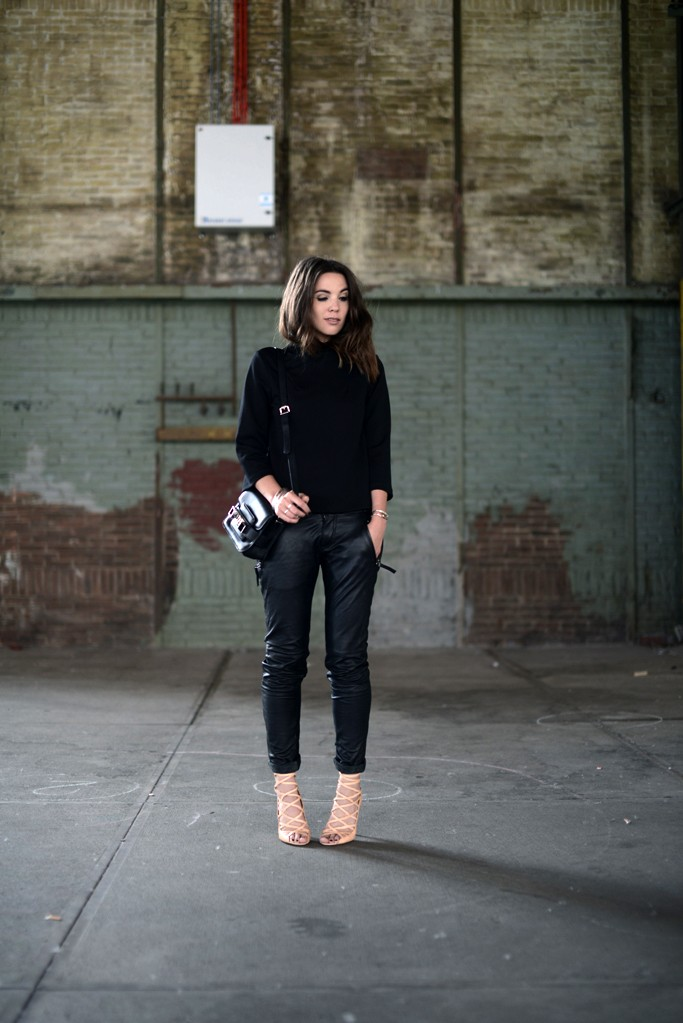 Cindy Van Der Heyden is wearing leather trousers from Gestuz, black top from H&M, bag from Proenza Schouler and shoes from Isabel Marant