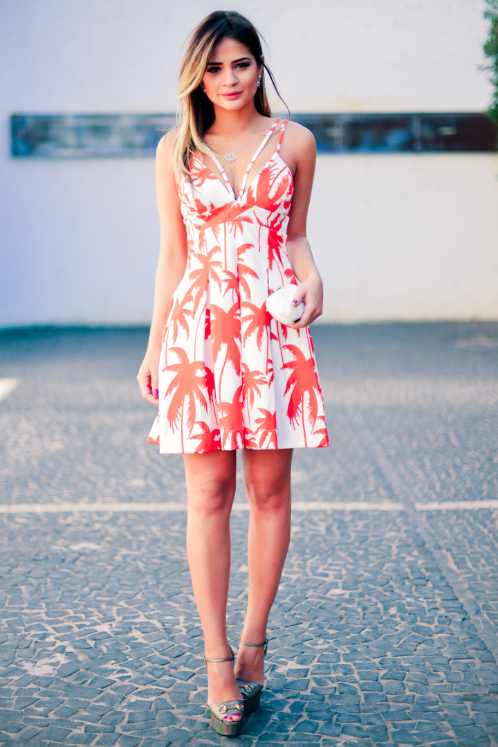 Thássia Naves is wearing a palm print dress from Skazi, and the clutch is from Serpui Marie
