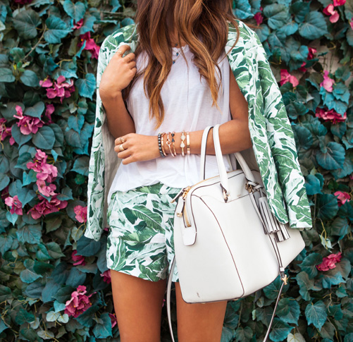 Aimee Song is wearing banana leaf blazer and shorts from Joie and the bag is from Coach