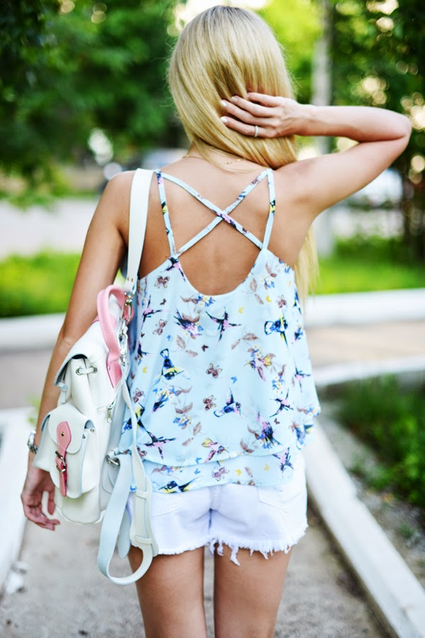 Valeriya Volkova is wearing tropical bird print top from Choies, white shorts from Sheinside, bag from Marc Jacobs