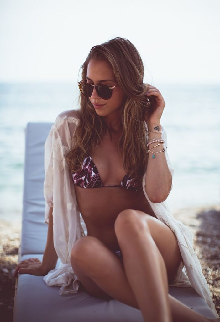Kenza Zouiten is wearing a tropical bikini top and bottom from Ivy Revel and a white kimono from Zara