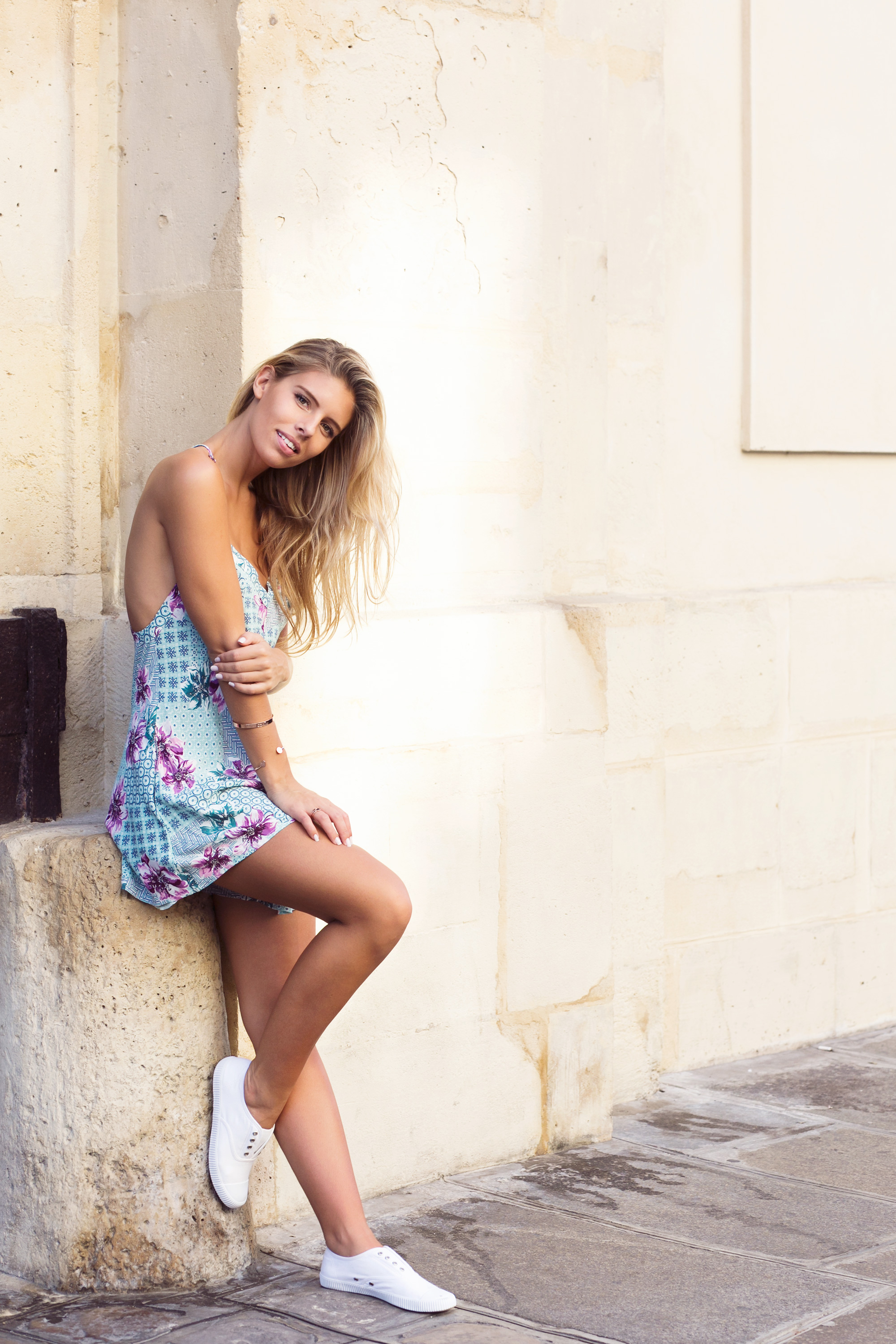 Natasha Oakley is wearing a tropical print jumpsuit from Tigerlily and shoes from Seed