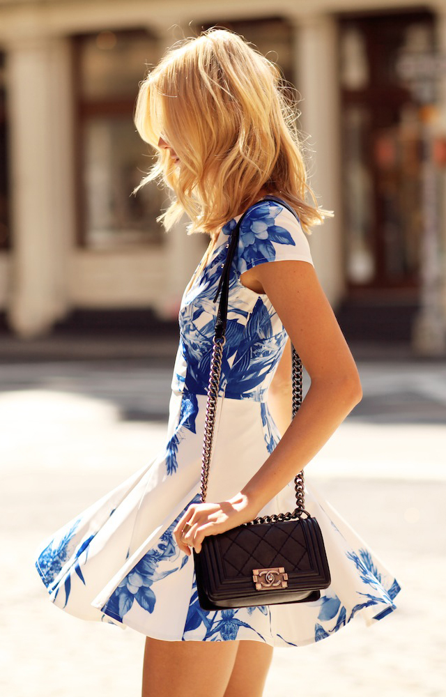 Jessica Stein is wearing a tropical print dress from Stylestalker and the bag is from Chanel