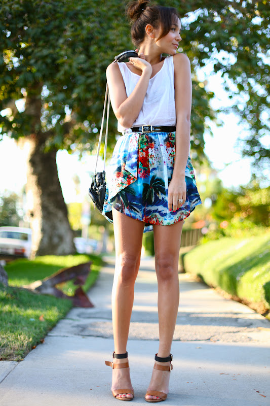Ashley Madekwe is wearing a tropical print skirt and sandals from Zara, white top from American Apparel and a bag from Alexander Wang