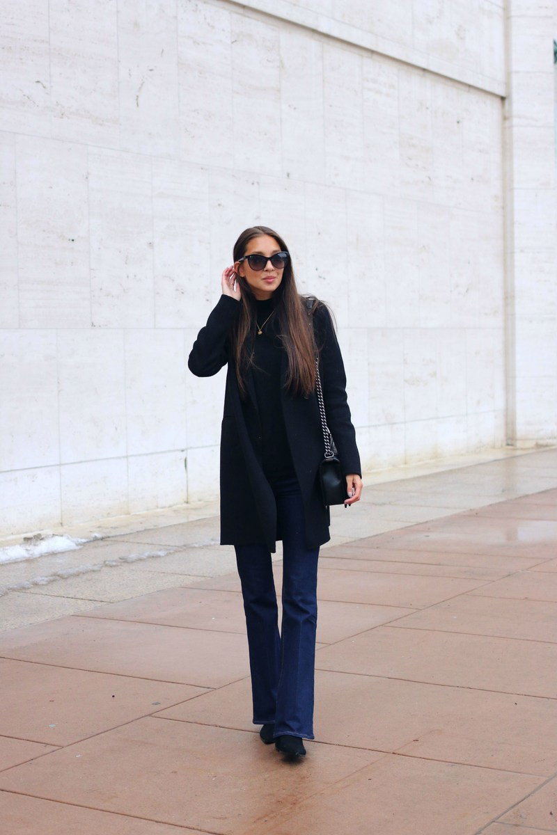 How To Style Flared Jeans: Felicia Akerstrom is wearing a pair of dark denim Topshop flares