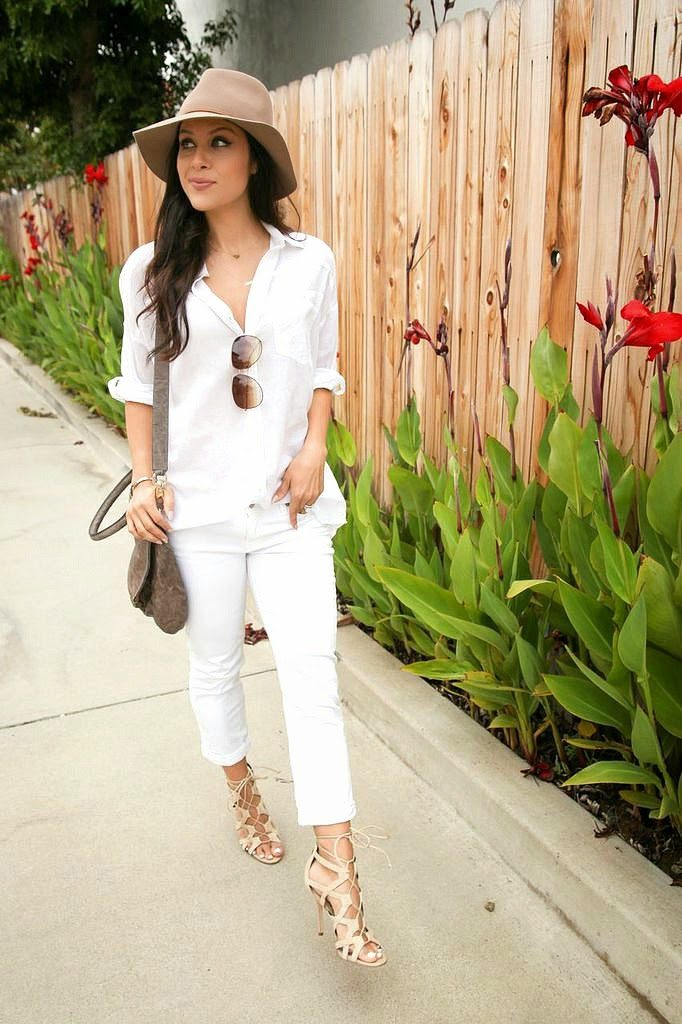 Andee Layne is wearing a white button down shirt from Urban Outfitters, whie jeans from Hudson, shoes from Sam Edelman, hat from Janessa Leone and the bag is from Givenchy
