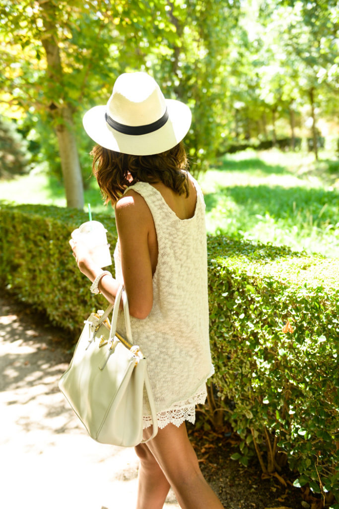 Alexandra Pereira is wearing lace trimmed shorts from Chicwish, top from Anine Bing, beige Panama hat and a bag from Prada