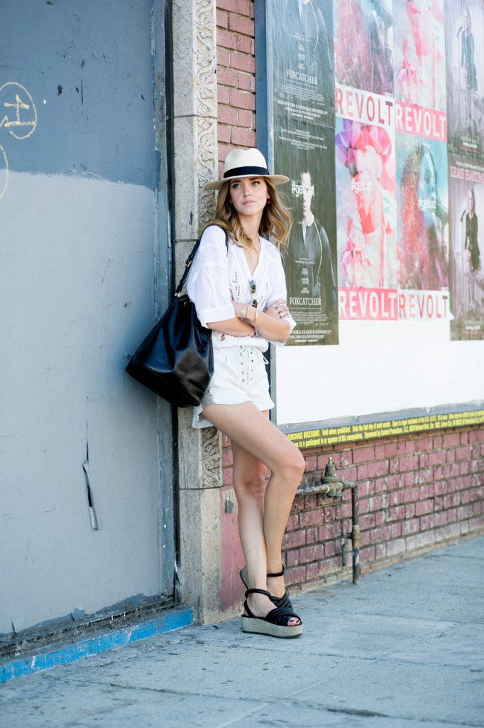 Chiara Ferragni is wearing wedges from Isabel Marant, shorts from Mlle Mademoiselle, shirt from Iro and a bag from Louis Vuitton