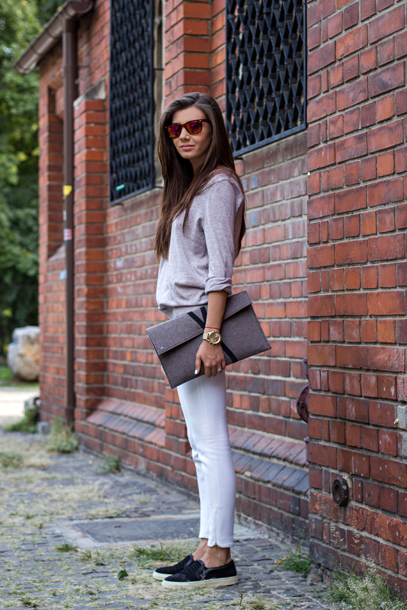 Larisa Costea is wearing black textured slip-ons from Choies