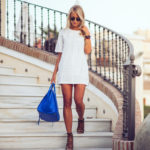 Janni Deler is wearing a white falbala dress from Choies, bag from Celine and lace up shoes from BubbleRoom