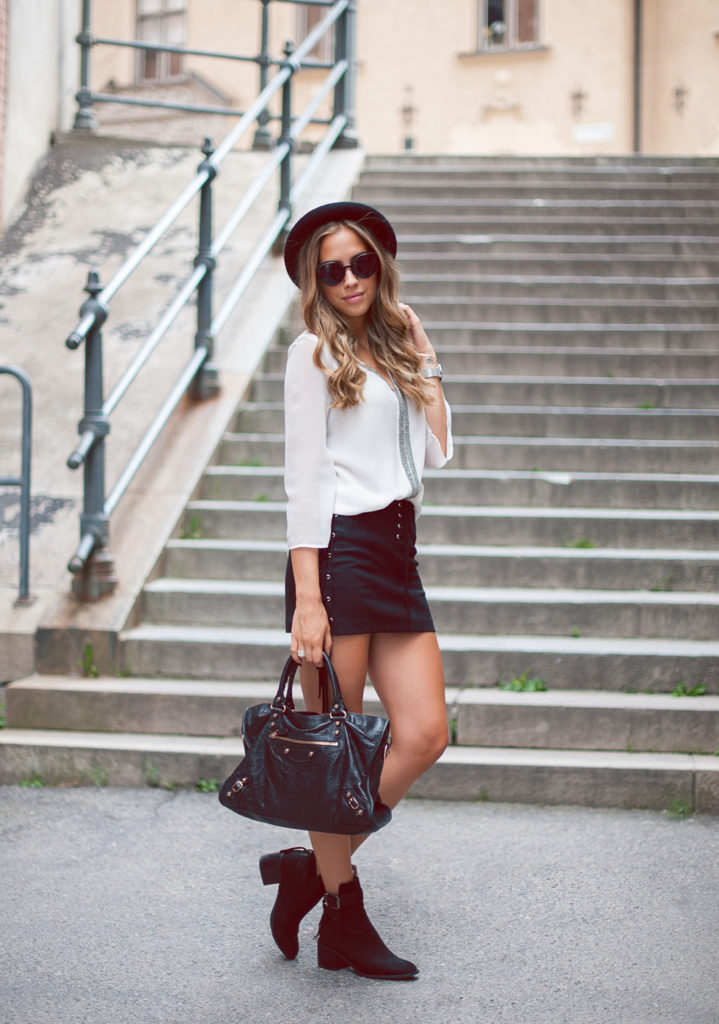 Kenza Zouiten is wearing a blouse and skirt from Zara, sunglasses from JFR,  bag from Balenciaga, boots from Jeffrey Campbell and a hat from TopShop