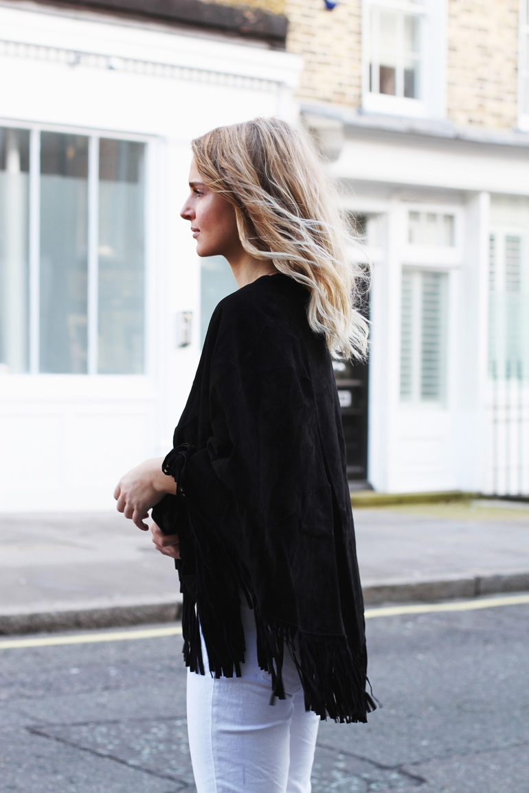 Fringe Fashion Trend: Mirjam Flatau is wearing a black Maje fringed poncho