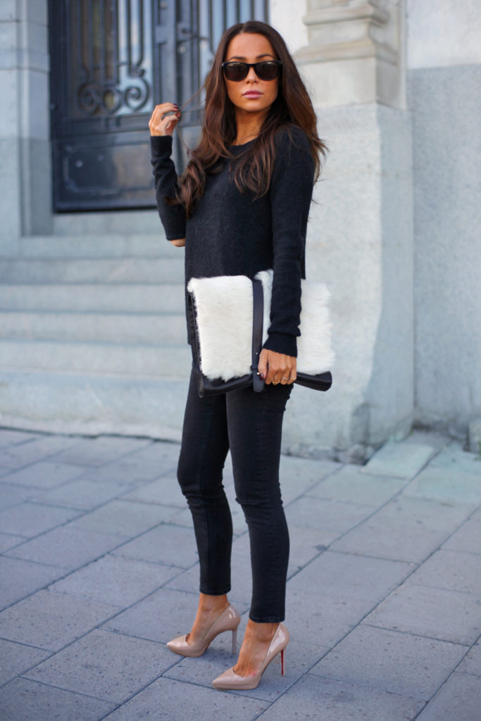 Johanna Olsson is wearing nude shoes from Chistian Loboutin, black jeans from Asos, black sweater from Won Hundred, sunglasses from Givenchy and the bag is from Little Liffner