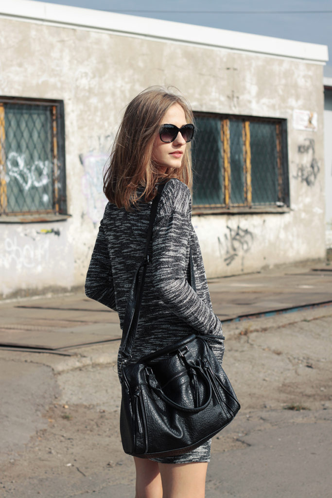 Karolina Sabala is wearing a grey and white patterned dress from New Yorker