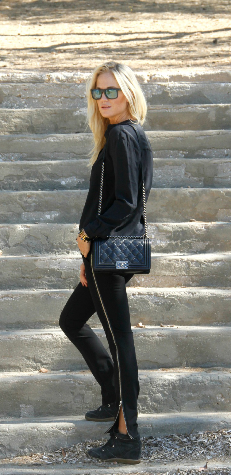 Josephine Ringblom is wearing a trousers from Zara, silk top, sneakers from Isabel Marant and the bag is from Chanel