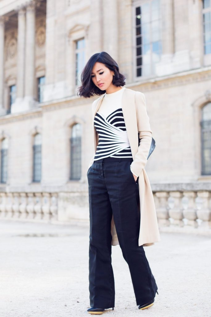 Nicole Warne is wearing a black and white top from Zara, flare trousers from Celine, coat from Elie Saab, bag from Mulberry and the boots are from Charlotte Olympia