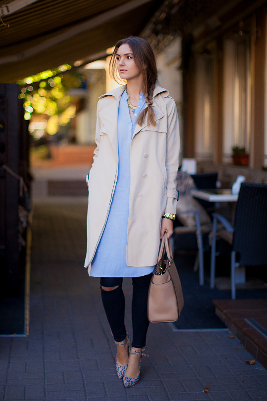 Nika Huk is wearing a trench coat from Chicwish, pale blue shirt dress from Chicnova, jeggings and shoes from Asos and the bag is from Michael Kors