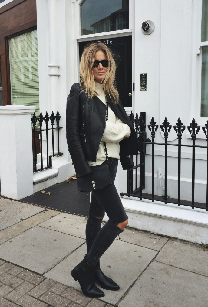 Lucy Williams is wearing black ripped jeans from Zara, white jumper from Gestuz, leather jacket from Belstaff and boots from LK Bennett