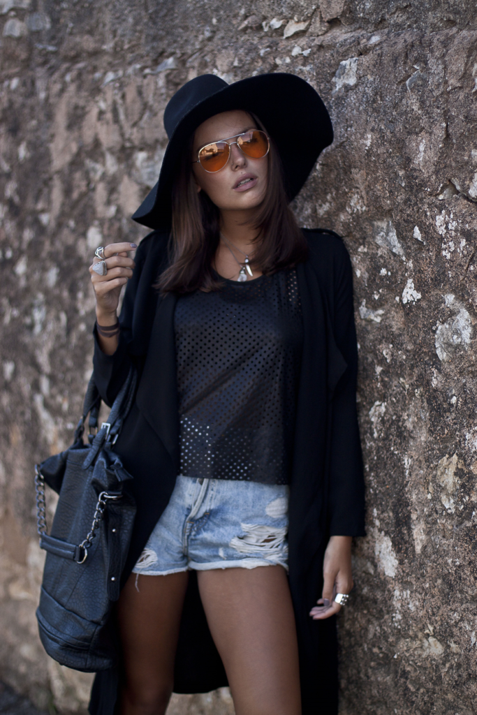 Mafalda Castro is wearing mesh top and bag from Fashion Pills, cover-up from SheInside, denim shorts from Pull & Bear and sunglasses from PartyGlasses
