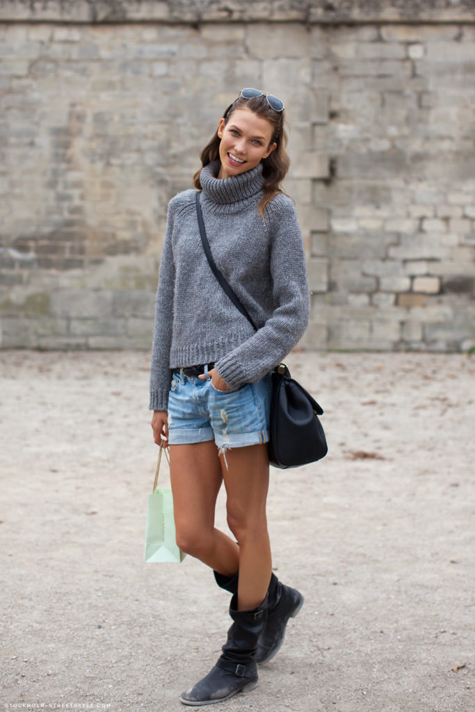 Karlie Kloss is wearing a knit turtleneck and denim cut offs Via Stockholm Streetstyle