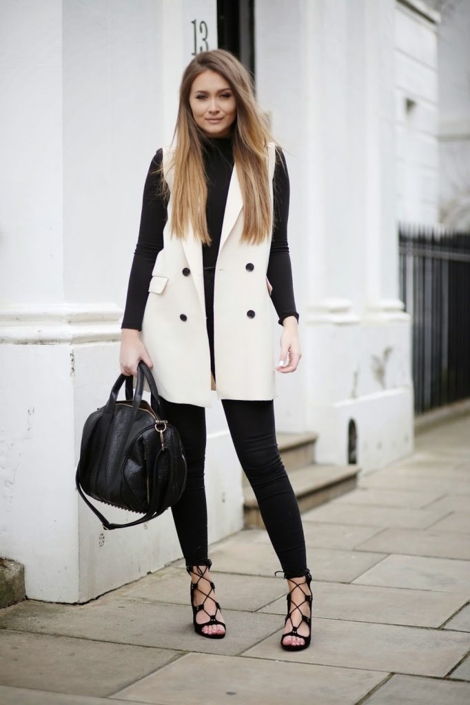 Sleeveless Fashion Trend: Sarah Ashcroft is wearing a white sleeveless Mac bershka jacket