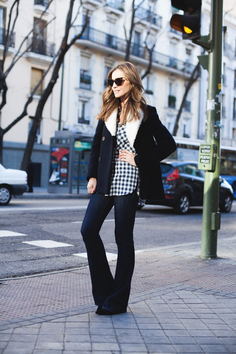 Gingham Trend: Silvia Zamora is wearing an oversized gingham shirt and jeans both from Zara