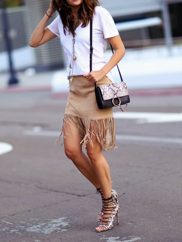 Fringed suede skirt, white tee and matching snake print lace up shoes and bag. Awesome. Via Erica Hoida  Skirt: Neiman Marcus, T-shirt: David Lerner, Bag: Chloe, Shoes: Aquazzura