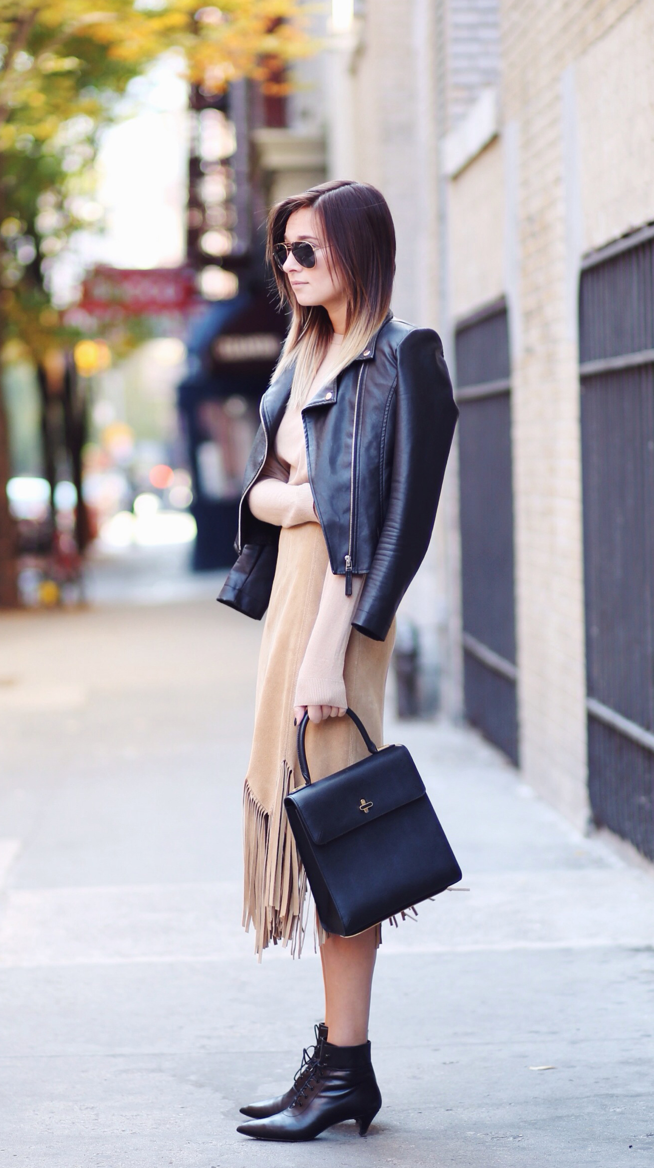 Fringe Fashion Trend: Danielle Bernstein is wearing a fringed suede skirt from Thrift Wares