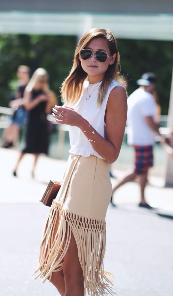 Danielle Bernstein is wearing a suede fringe skirt from Cris Barros