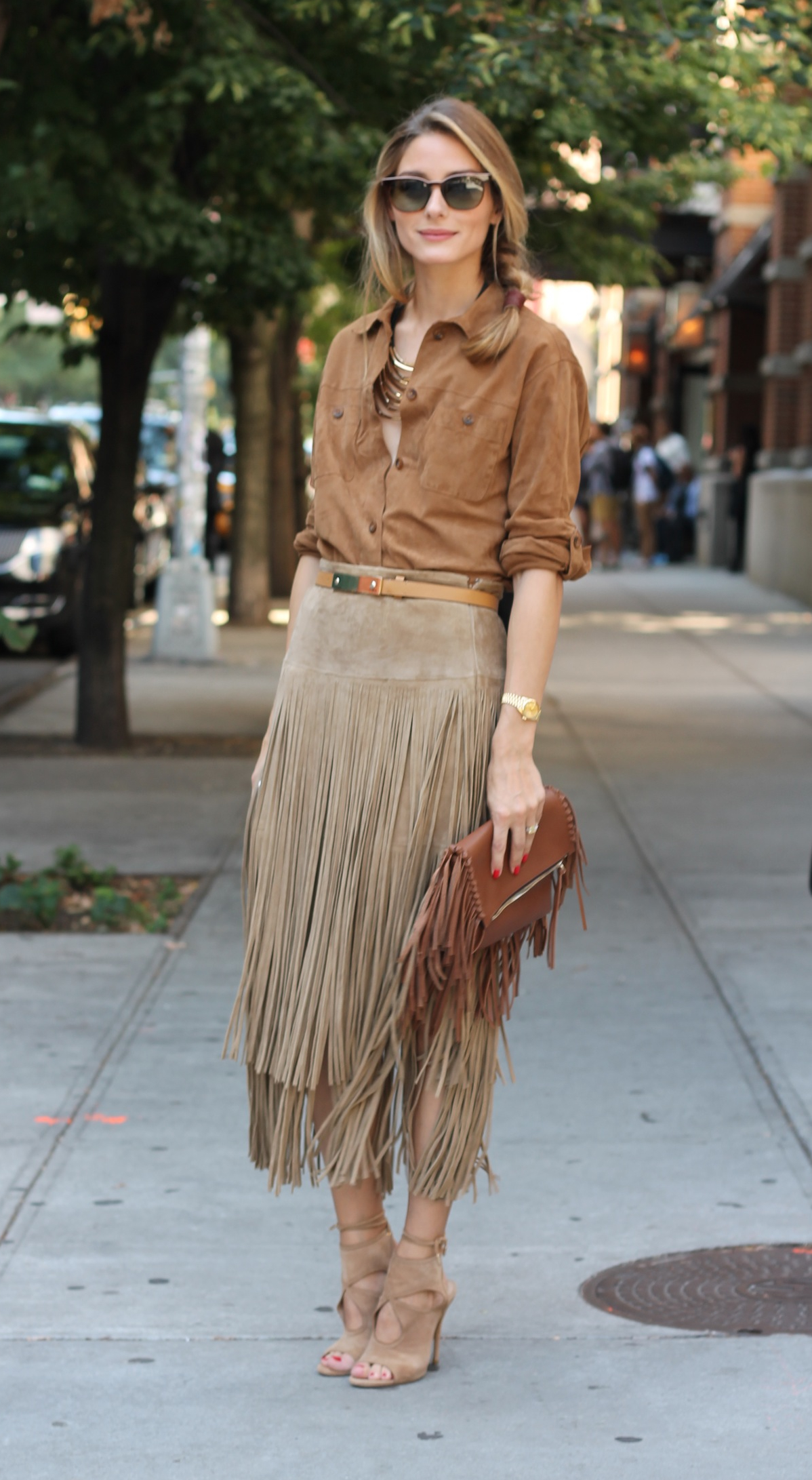 Olivia Palermo is wearing a suede fringe skirt from Michael Kors, suede blouse from Gerard Darel, bag from Carolina Herrera and the shoes are from Aquazzura