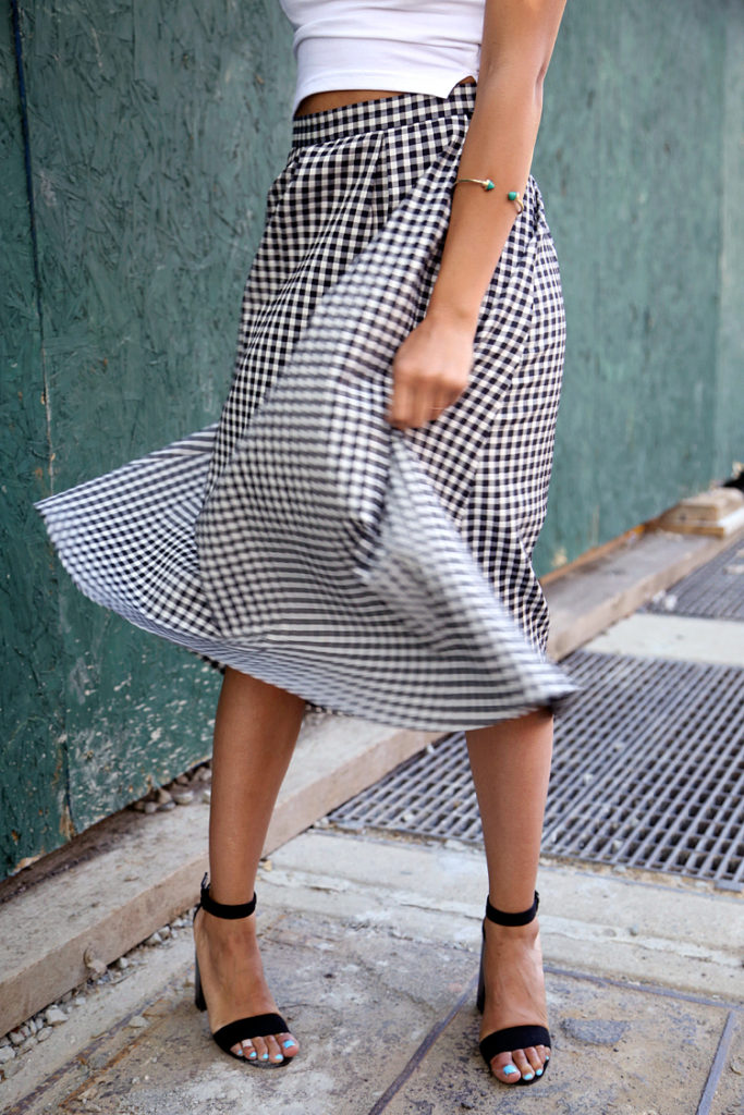 Erica Lave wearing a cropped turtle neck and a gingham full skirt From TopShop
