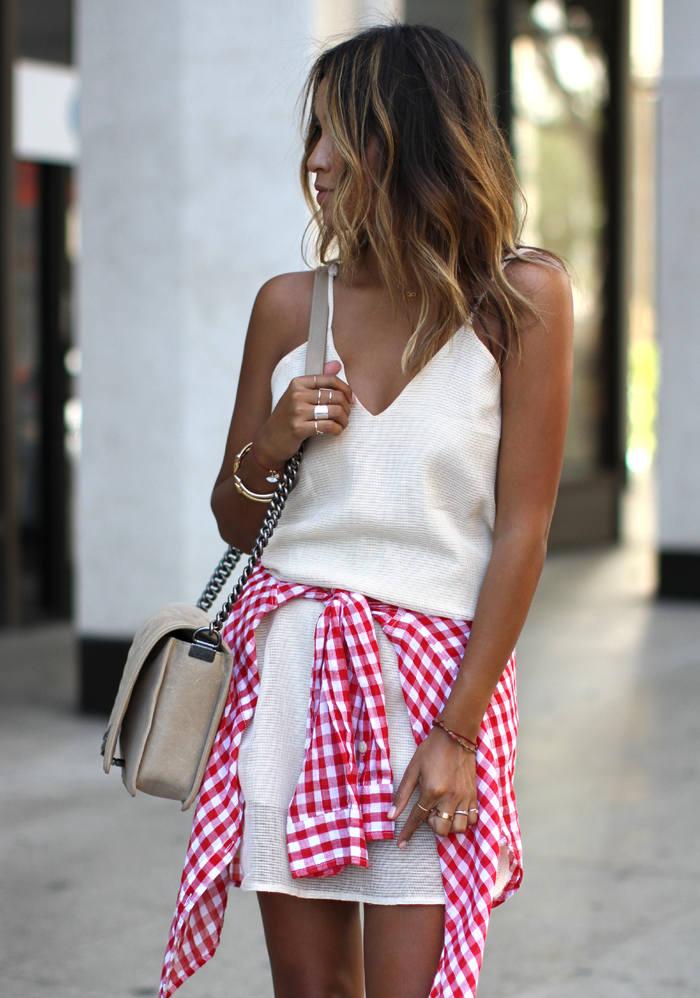 Julie Sarinana is wearing a red and white gingham shirt from Ralph Lauren and a white dress from Vivian Chaan