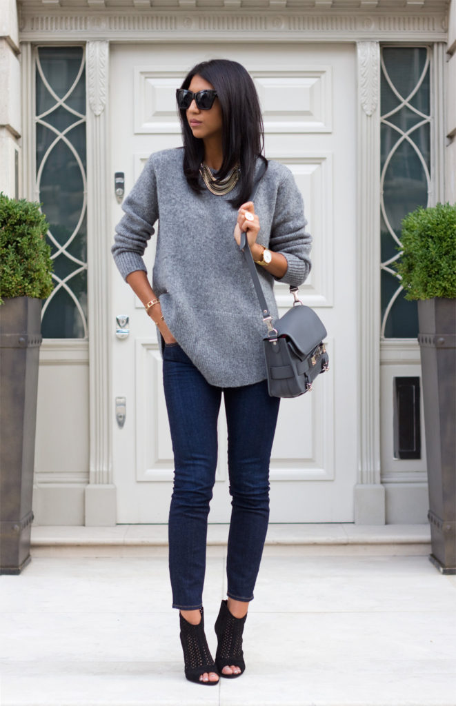 Kayla Seah is wearing an oversized grey sweater and jeans from & Other Stories, bag from Proenza Schouler, sunglasses from Le Specs and shoes from Zara