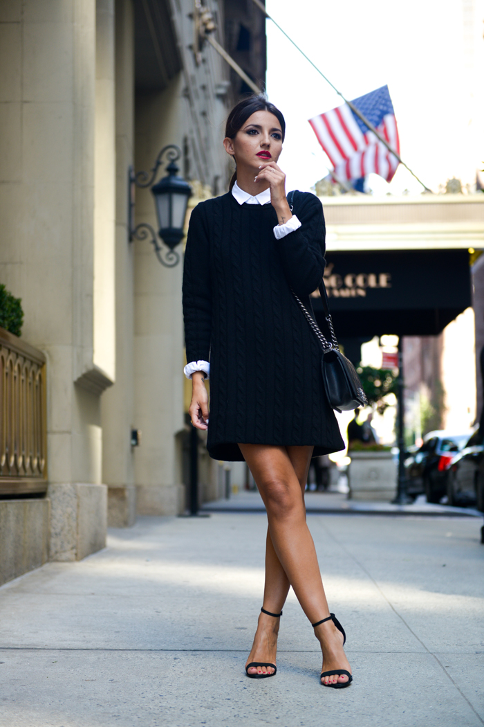 Alexandra Pereira is wearing a knit sweater dress and shirt from Lacoste, bag from Chanel and the shoes are from Schutz