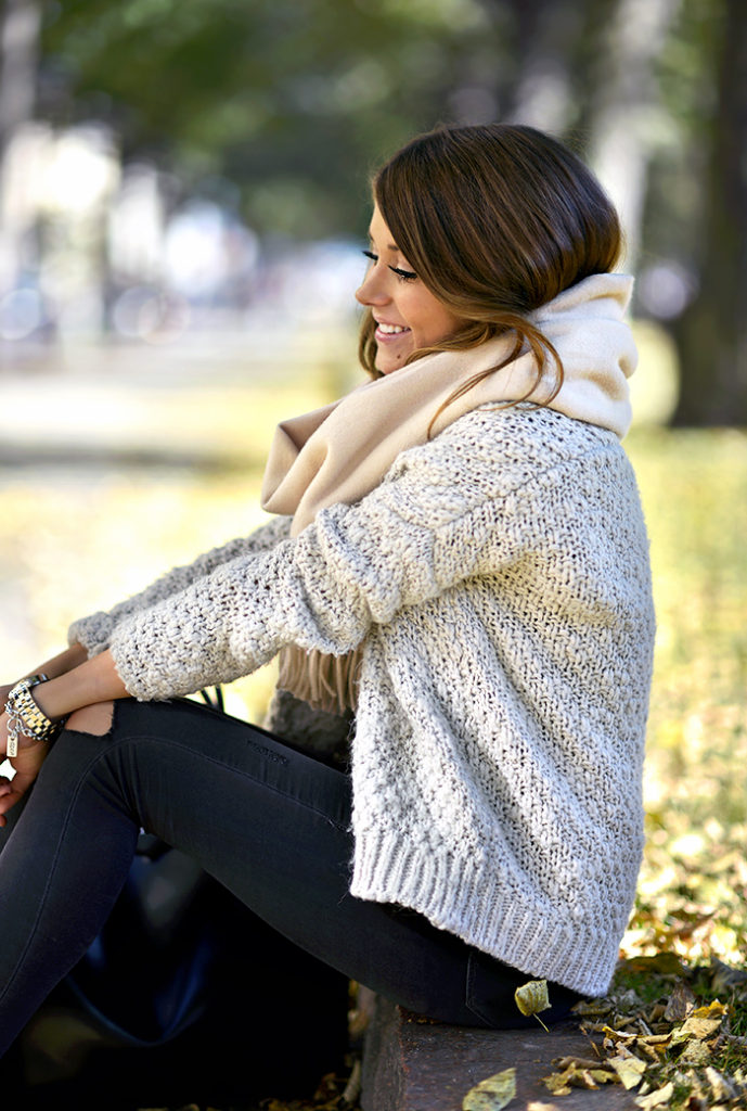Marianna Mäkelä is wearing a knit cardigan from Zara, scarf from Acne, and ripped jeans from TopShop