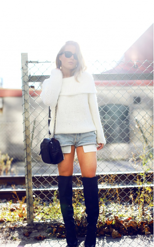 Angelica Blick is wearing a white knit top from Notion 1.3, denim cut offs from Levis, boots from H&M and the bag is from Zara