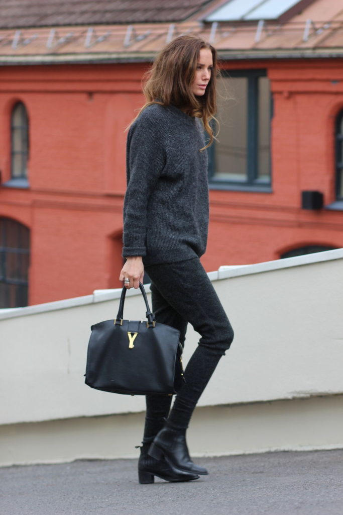 Benedichte is wearing a dark grey knit top from Envii