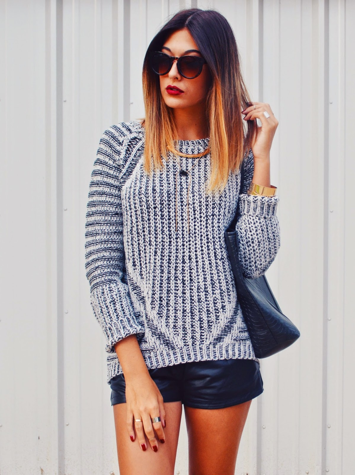 Danielle DeHardt is wearing a grey knitwear sweater from Dex Clothing