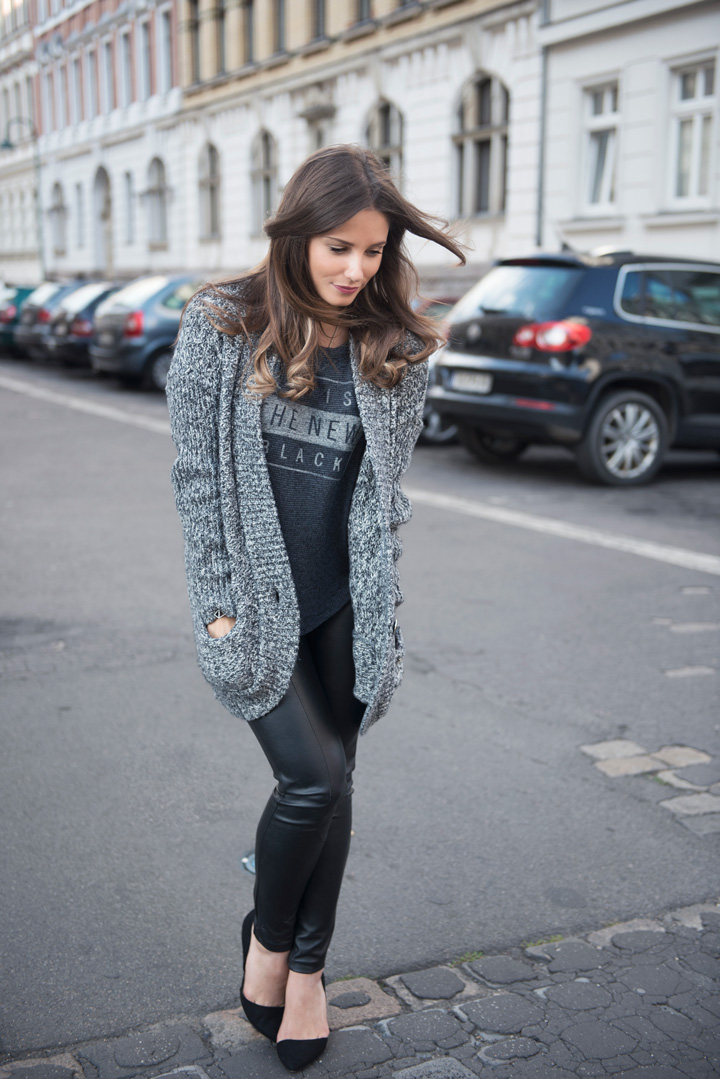 Tanja Henkel is wearing a grey knit oversized cardigan from Guess