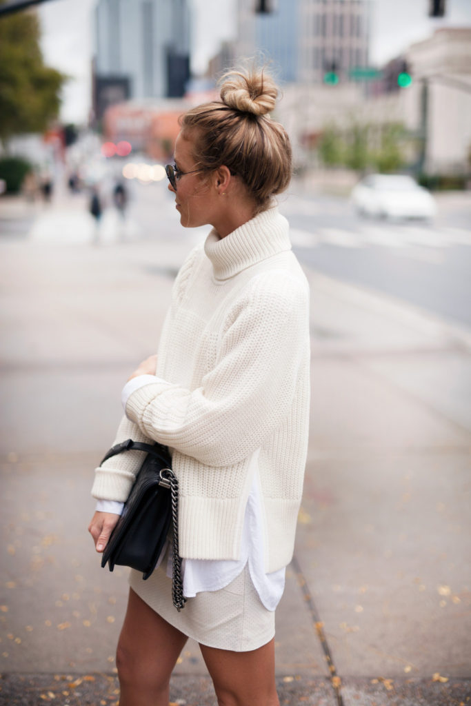 Mary Seng in a white chunky knit turtleneck sweater from Helmut Lang