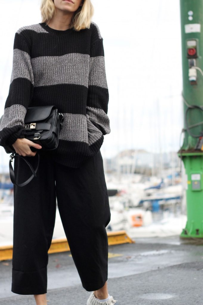 Tine Andrea is wearing black and grey striped knitwear from Weekday