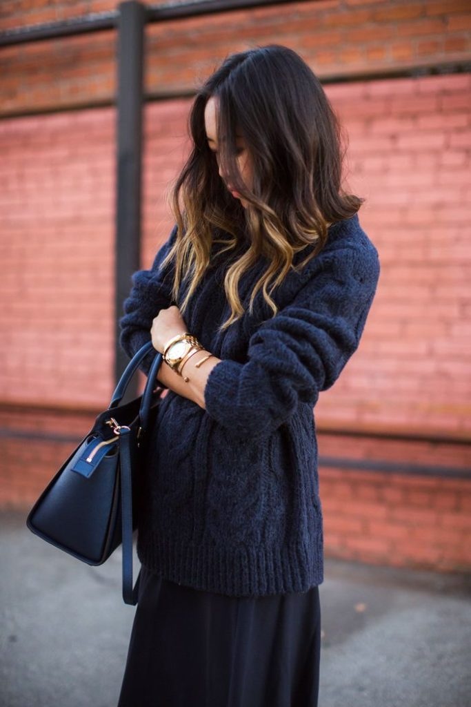 Aimee Song is wearing navy blue knitwear from Michael Kors