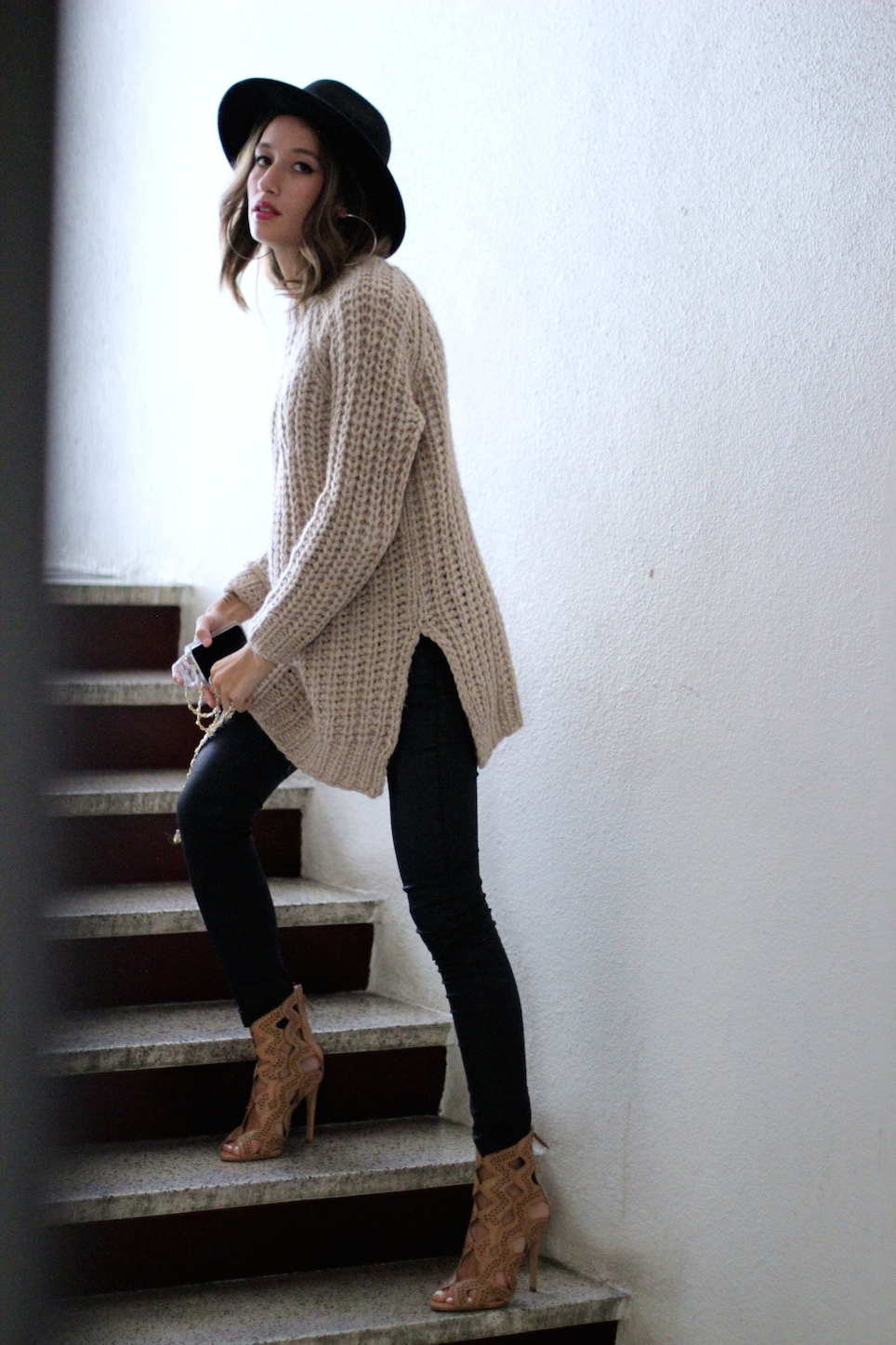 Alexandra Guerain in her heavy knit by Zara