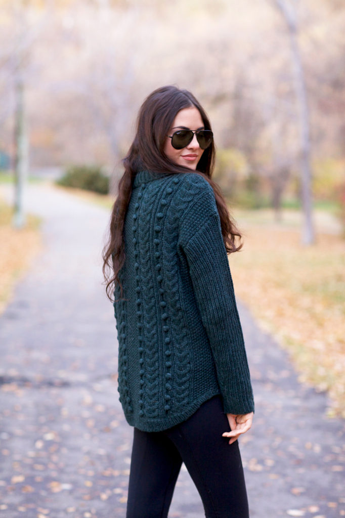 Rachel Parcell is wearing a bottle greeen cable knit sweater from Talbots