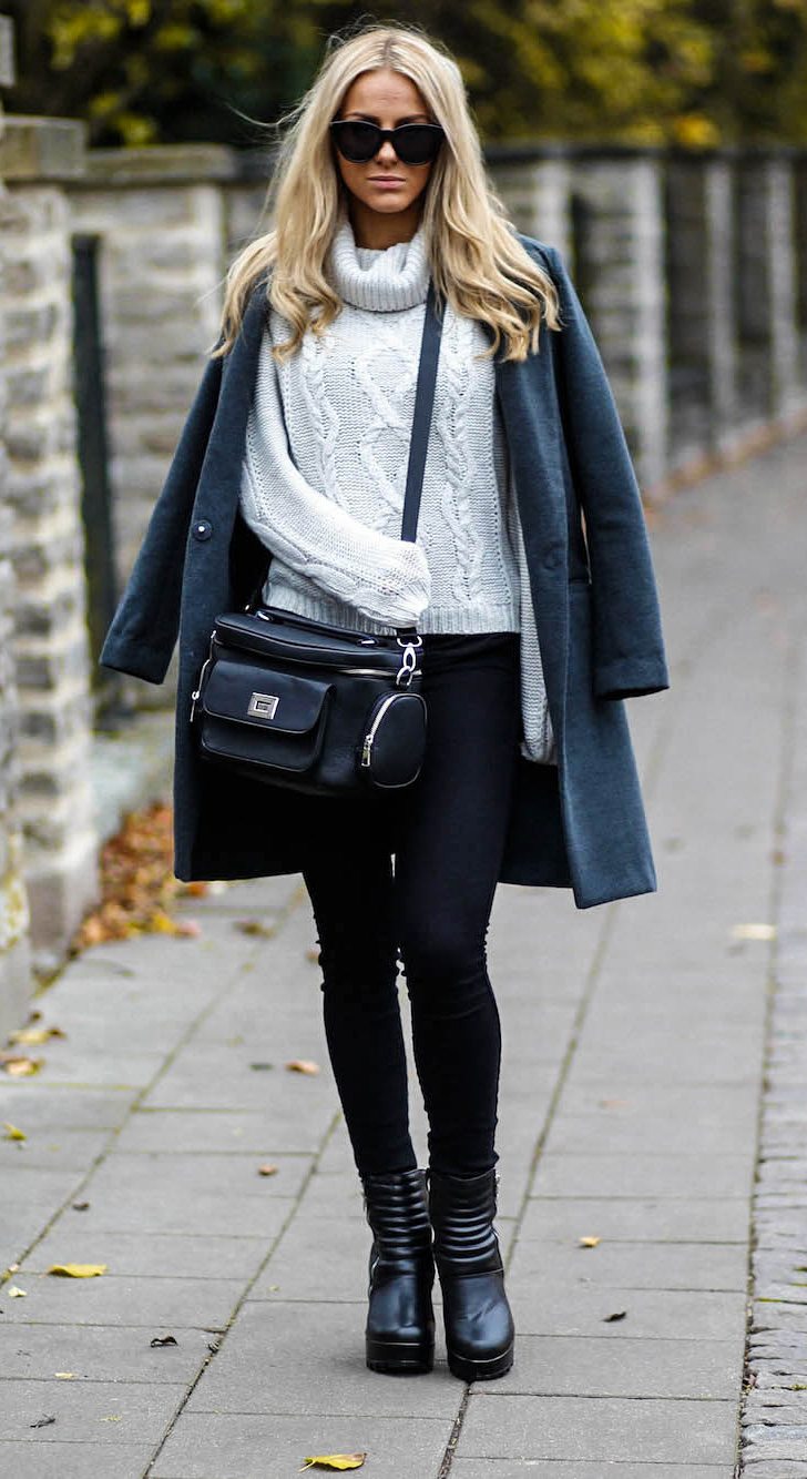 Sendi Skopljak is wearing a heavy knit grey sweater from Rut & Circle