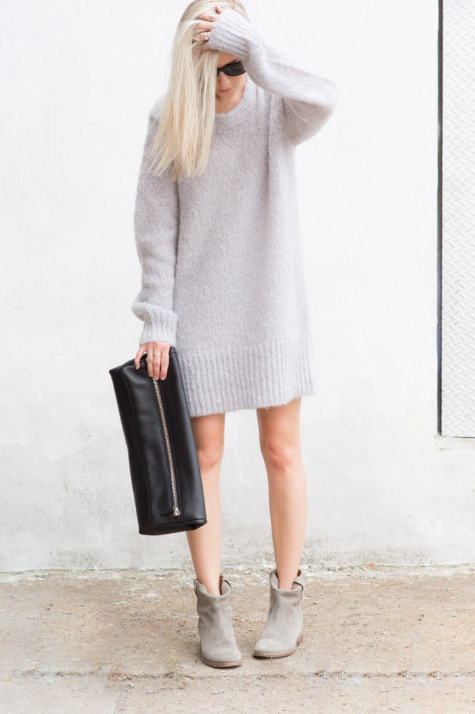 Figtny is wearing a knit sweater dress and clutch from Aritzia Wilfred and boots from Isabel Marant