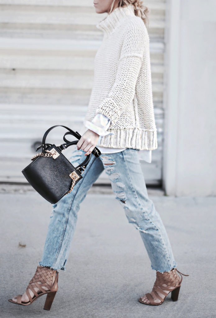 Knitwear Trends: Mary Seng is wearing a cream chunky cotton cowl neck sweater from Free People