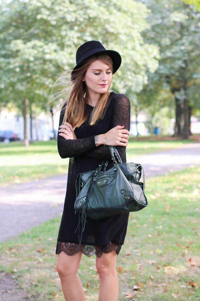 Magdalena Ilic is wearing a black lace dress from Free People Dress, and th bag is from Lush