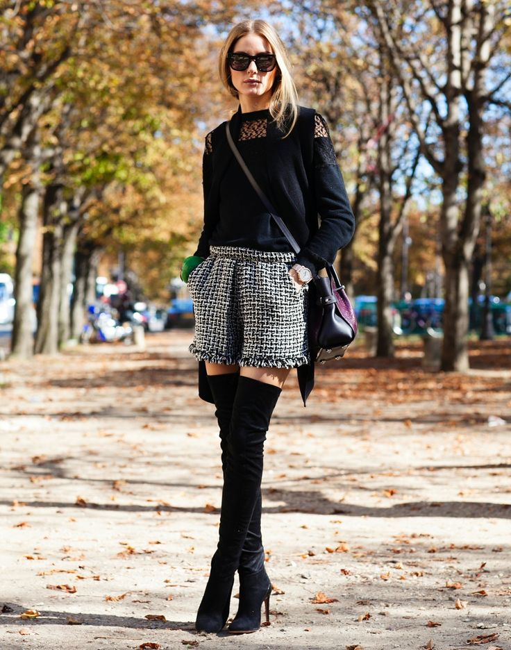 Olivia Palermo is wearing a black lace and silk trimmed top and bag from Nina Ricci, tweed shorts and vest from Thurley, sunglasses from Westward Leaning and the boots are from Aquazzura